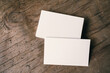 canvas print picture - Pile of white blank space business name cards stack template for advertise and marketing on wooden texture background, clipping path for insert your banner text design for present the company brand