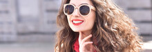 Fashion Portrait Stylish Pretty Woman In Sunglasses Outdoor. Young Smiling Woman. Street Fashion. Red Lipstick.