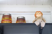 Toy Brownie Sits On The Top Shelf With Jars Of Jam, Summer Cottage, Country House