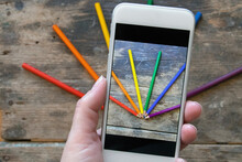 Woman Takes Picture Of  LGBT Colors Made By Colorful Pencils