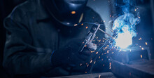 Professional Welder Performs Work With Metal Parts In Factory, Sparks And Electricity. Industry Worker Banner