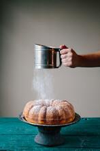 Sifting Powdered Sugar On Bundt Cake