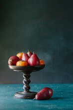 Persimmons And Red Pears In Bowl