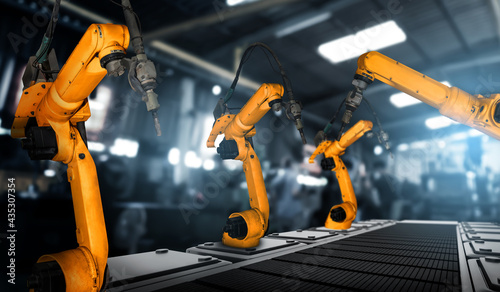 Stampa su Tela Mechanized industry robot arm for assembly in factory production line