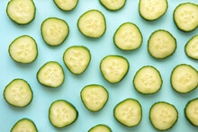Flat Lay With Cucumber Slices On Light Blue Background