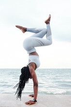 Fit Strong Young Sportswoman Doing Handstand On Embarkment With Beautiful Sea In Background