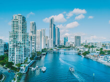 An Aerial View Of Surfers Paradise As A Boat Travels Up The River