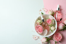 Skin Care Concept With Essential Rose Oil On Two Tone Background
