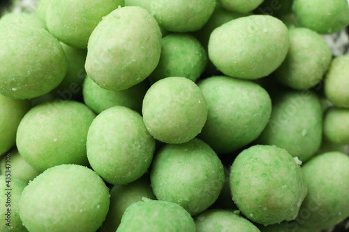 Canvas Print Tasty wasabi nuts on whole background, close up