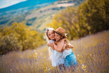 Mother And Daughter In Lavender Filed.
