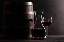 Decanter, Red Wine And Old Wooden Barrel