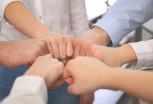 People Holding Fists Together In Office, Closeup