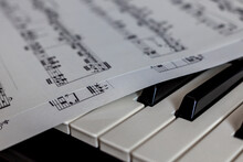 Close Up Of Piano Keys With Public Domain Music Score Resting On Top