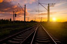 Railroad At Sunset. Rail Freight And Passenger Transportation.