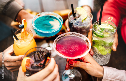 Fotografia, Obraz People hands toasting multicolored fancy drinks - Young friends having fun toget