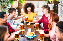 Young Gen Z People Drinking Beer At Brewery Bar Terrace - Friendship Life Style Concept With Young Milenial People Enjoying Happy Hour Time Together At Penthouse Pub
