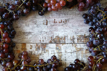 Blue Grapes On A Wooden Surface.