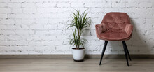 Pink Chair And Flower Pot On White Brick Wall Background. Minimalism Interior Design. Banner Copy Space