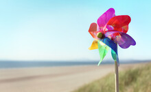 Summer Beach Background, Pinwheel Or Windmill In The Sand