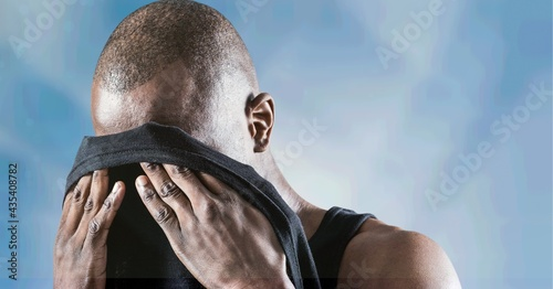 Composition of muscular strong man wiping face with t shirt