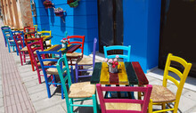 Restaurant Cafe In Preveza City Greece Multicolortables And Chairs Flowers Pots