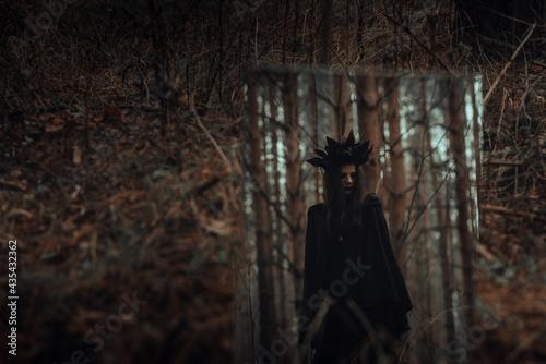 Obraz na plátně reflection of a dark frightening witch in a mirror
