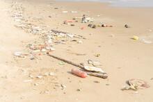 Trash On Tropical Beach. Plastic Pollution Environmental Problem.