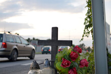 View Of Roadside Memorial With Cross, Candles And Flowers. All Souls' Day