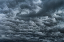 Dramatic Sky With Storm Clouds Before Rain. Panoramic View Of The Stormy Sky And Dark Clouds.  Concept On The Theme Of Weather, Natural Disasters.