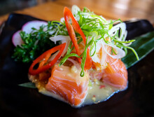 Hot And Spicy Salmon Salad Mix Vegetable Tomato Herb And Spices Thai Style Food.