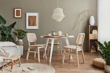 Stylish Interior Of Dining Room With Family Table, Rattan Chairs, Pendatn Lamp, Plant, Tableware, Carpet, Decoration And Elegant Accessories. Template.