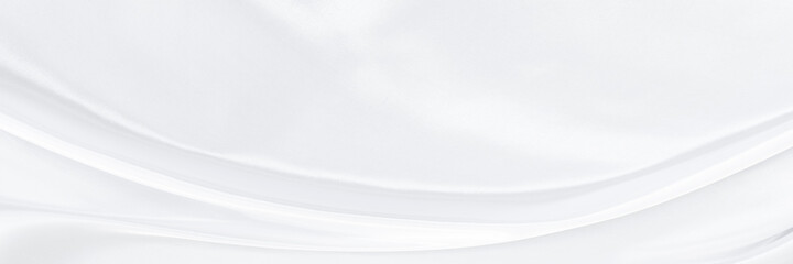 White gray satin texture that is white silver fabric silk panorama background with beautiful soft blur pattern natural.