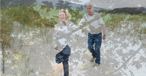Composition of senior couple holding hands, walking on beach and autumn foliage