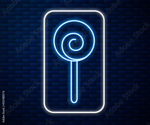 Fotografia Glowing neon line Lollipop icon isolated on brick wall background
