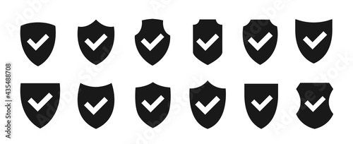 Fotografia Shield with checkmark icon set