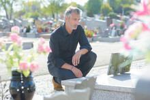 Portrait Of Man Man Mourning At Grave
