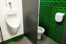Wall-mounted Urinal And Men's Toilet In Public Toilets.