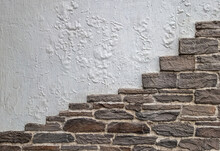 Wall With Bricks And Part Of Whitewash