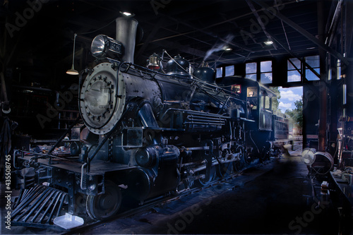 Fototapeta A old steam engine train in the barn for service while cooling down