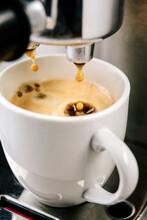 Drips Of Espresso Into Espresso Cups