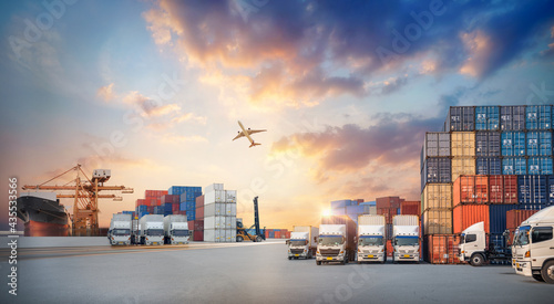 Container truck in ship port for business Logistics and transportation of Container Cargo ship and Cargo plane with working crane bridge in shipyard, logistic import export concept