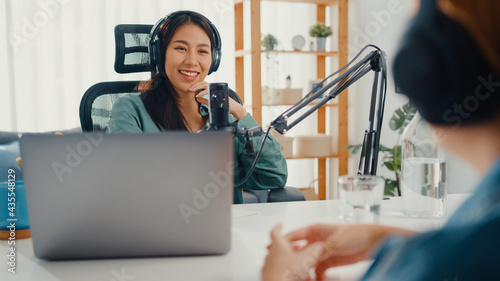 Fotografiet Asia girl radio host record podcast use microphone wear headphone interview celebrity guest content conversation talk and listen in her room