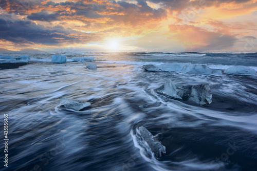 Beautiful sunset over famous Diamond beach, Ice floe on black sand Iceland beach Fototapet