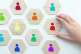 image of tangram blocks with people icons over wooden table ,human resources and management concept - 435558197