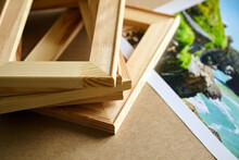 Photo Canvas Print And Wooden Stretcher Bars On Table. Landscape Photography Printed On Canvas