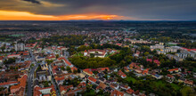 Sarvar, Hungary - Aerial Panoramic View Of The Castle Of Sarvar (Nadasdy Castle) With Sarvar Arboretum, A Beautiful Dramatic Sunrise And Rain Clouds At Background On A Calm Autumn Morning
