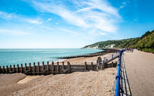 Eastbourne Promenade And The South Downs, England. A Bright, Summer View Of The Beach West Along The Prom Towards The White Cliffs And South Downs.