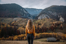 Rear View A Of Blonde Female Standing And Enjoying The Autumn Mountains.travel And Lifestyle Concept