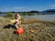 Boy With Toy On Beach