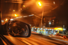 Night Trip On Car Background, Abstract Blurred Rear View Mirror Urban Road
